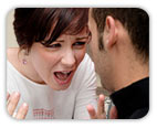Upset woman crying and yelling at confused boyfriend