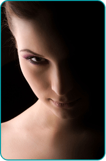 A menacing portrait of a woman with stark lighting contrast
