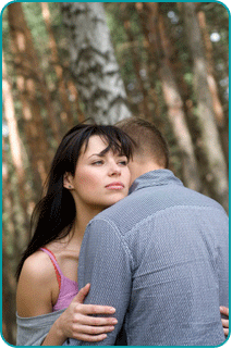 A woman hugging her ex, wondering if it's a good idea to get back together