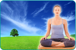 A meditating woman in the lotus position with a sunny, grassy meadow in the background