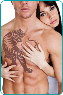 A shirtless man with a tiger tattoo held from behind by a woman