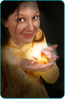 A woman manifesting a glowing butterfly in her cupped hands