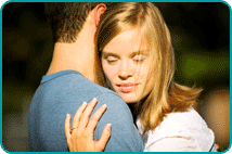Smiling blonde woman hugging man