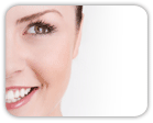 Left side of smiling woman's face