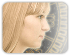 Profile of woman's face over an astrological wheel in background