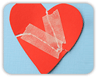 Ripped paper heart, taped back together
