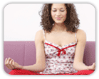 Smiling, meditating woman in lotus position