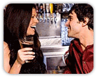 Scene from a bar, woman laughing on date with guy