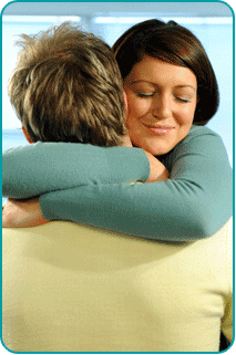 Smiling woman hugging man, secretly wanting more to their friendship