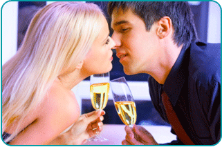 Couple kissing on New Year's Eve, holding champagne glasses and hoping for love in the new year