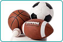 A basketball, soccer ball, football and baseball