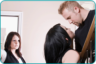 A woman walking in on a man about to kiss his wife