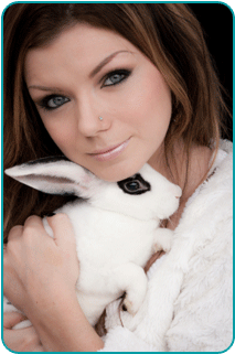 A woman holding a rabbit