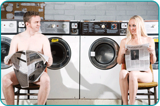 A man and a woman both doing last minute laundry in the laundromat, eyeing each other with romantic interest
