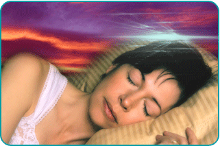 A woman dreaming while sleeping in bed