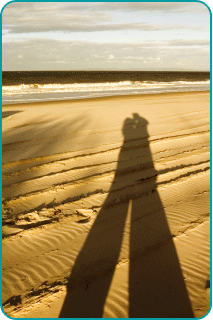 The shadow of an embracing couple on the beach