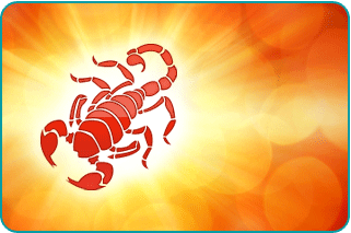 A Scorpio scorpion with a sun starburst behind it