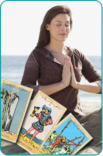 Three Tarot cards with a woman meditating on a beach in the background