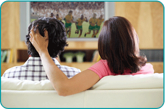 couple in love relationship watching sports
