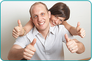 A woman behind her husband as both give the 'thumbs up' to their relationship