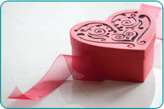 A pink heart-shaped Valentine's Day gift box