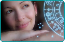 A psychic woman looking wistfully at a glowing zodiac wheel